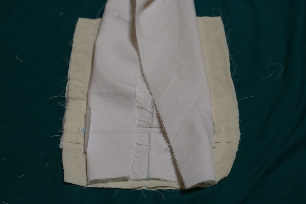 Fold the sides of the back leg piece such that you can see the slit edge stitching